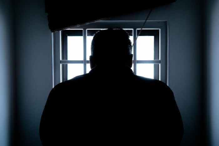 silhouette of a man in window